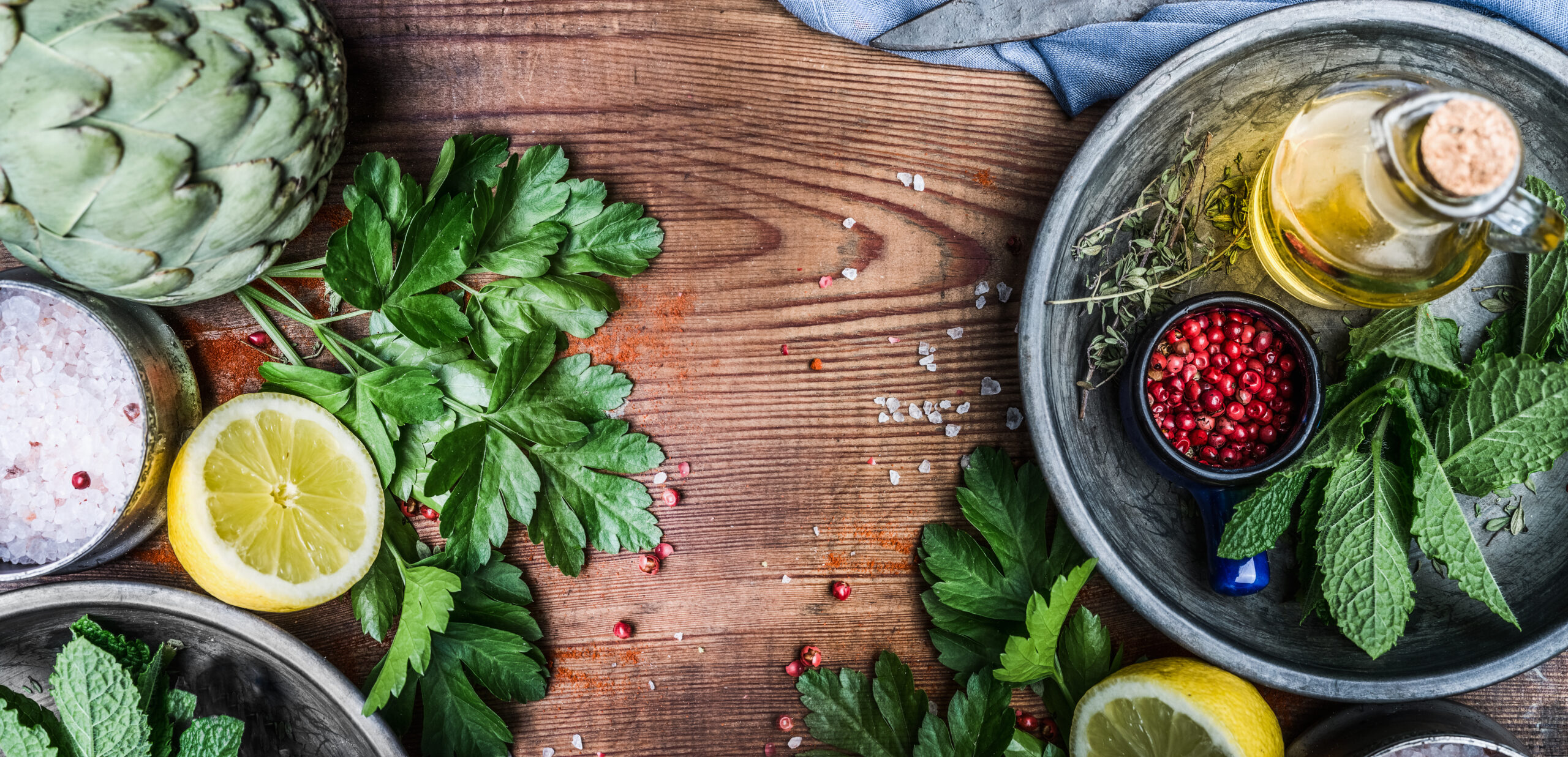Healthy eating and cooking with fresh organic ingredients. Herbs,spices and olives oil on rustic wooden background, top view, banner